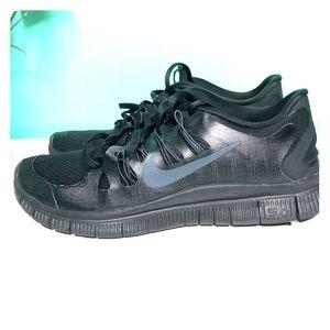 All Black Nike Running Sneakers.